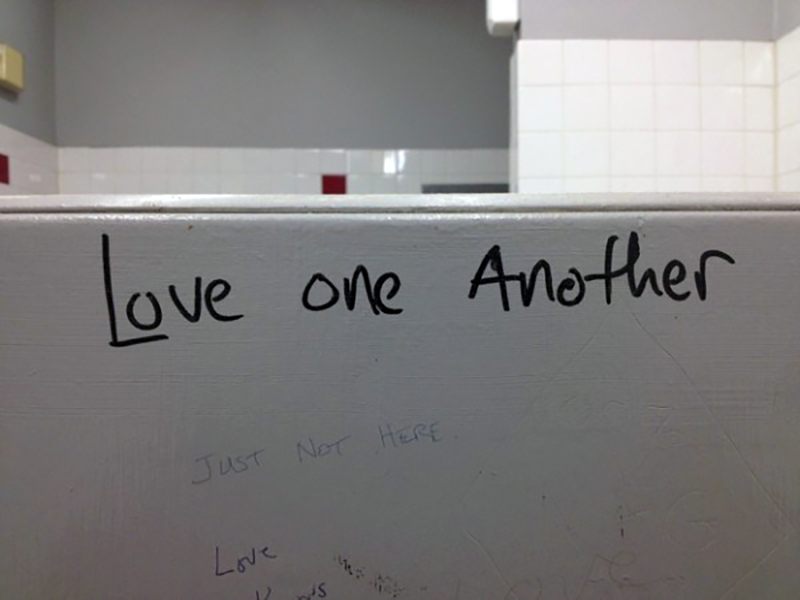 A bathroom wall reads