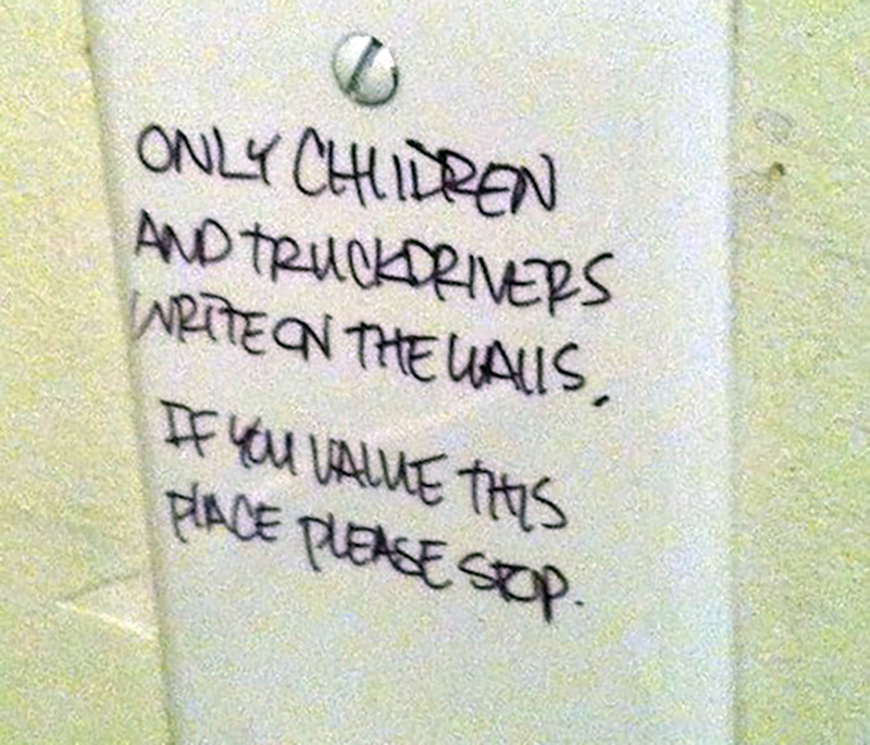 A bathroom wall claims that only children and truckdrivers write on walls.
