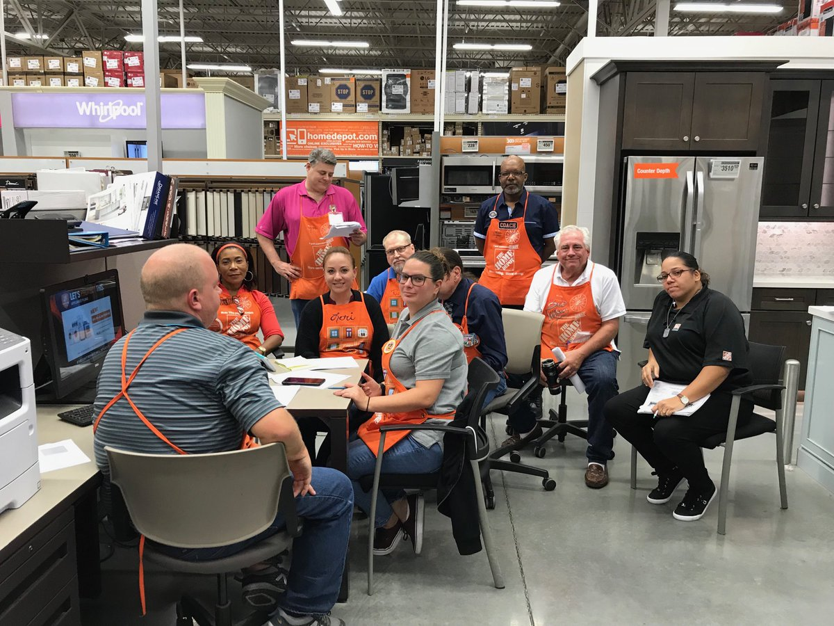 Employees of Home Depot sit in display furniture.