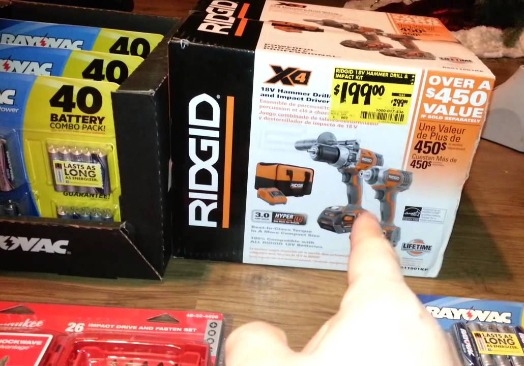 A person points to a tool on sale at Home Depot.