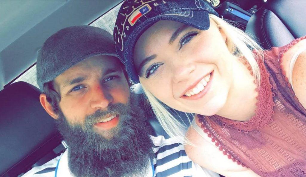 Heather and Joshua take a selfie.