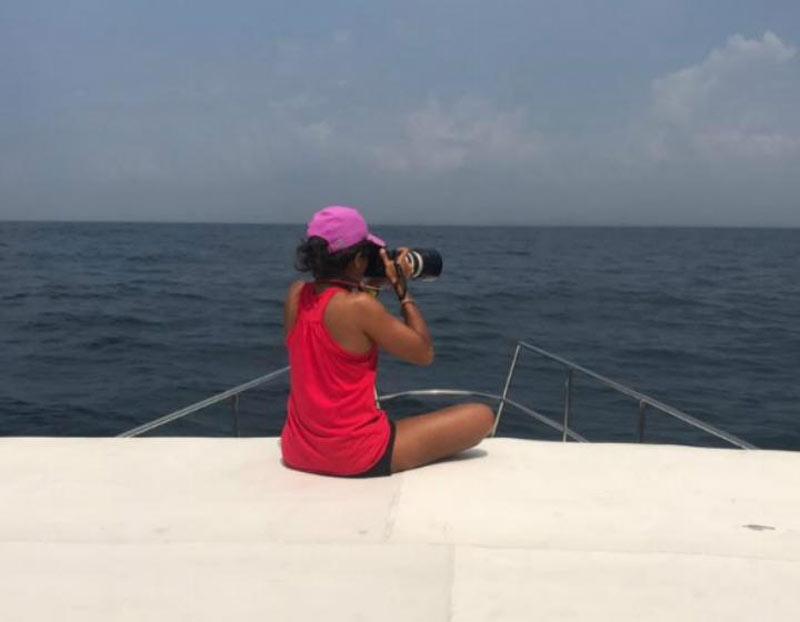 Asha-de-Vos spotting creature with her camera