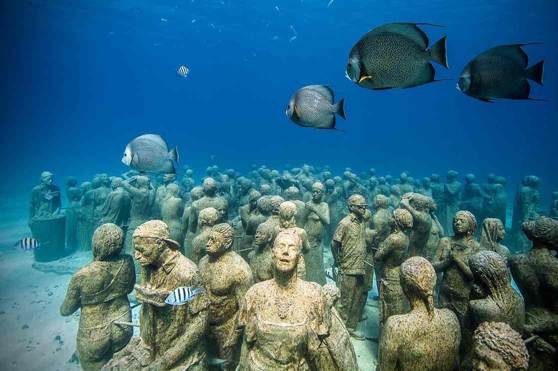Hundreds of life-sized human sculptures are seen underwater in the Museo Atlántico.
