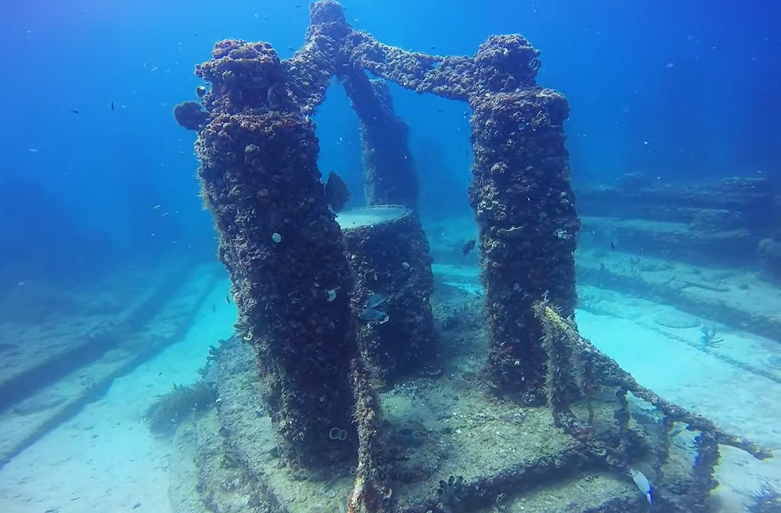 An arch overhangs an underwater crematory.