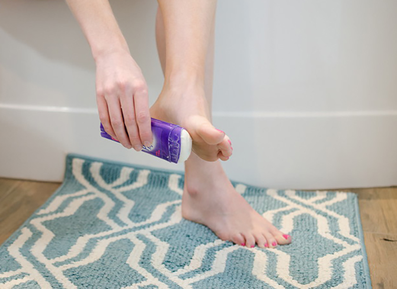 applying-deodorant-to-feet