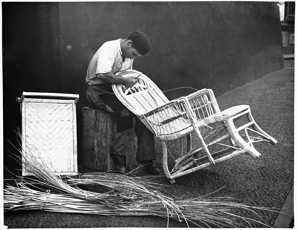 Man making a cane chair
