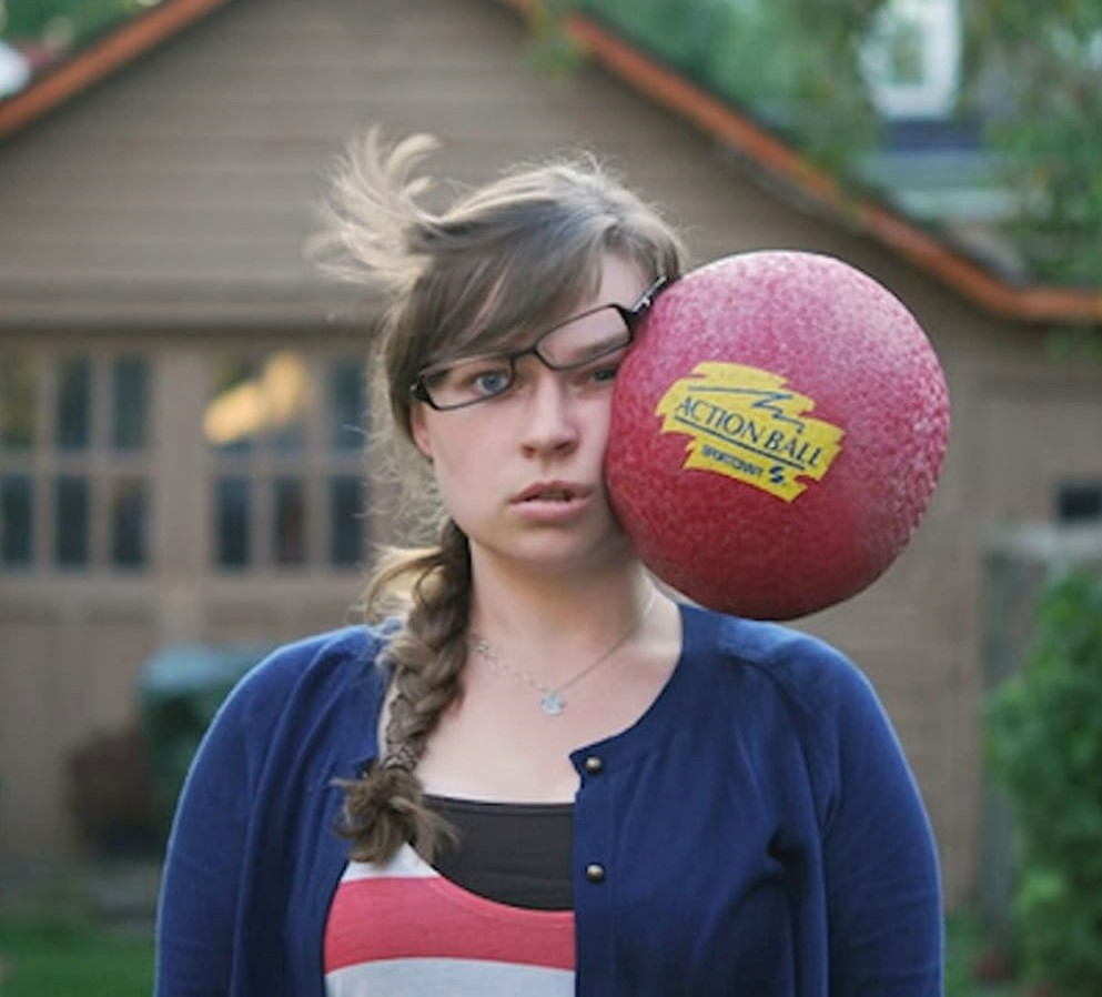 girl-getting-hit-in-face-by-rubber-ball