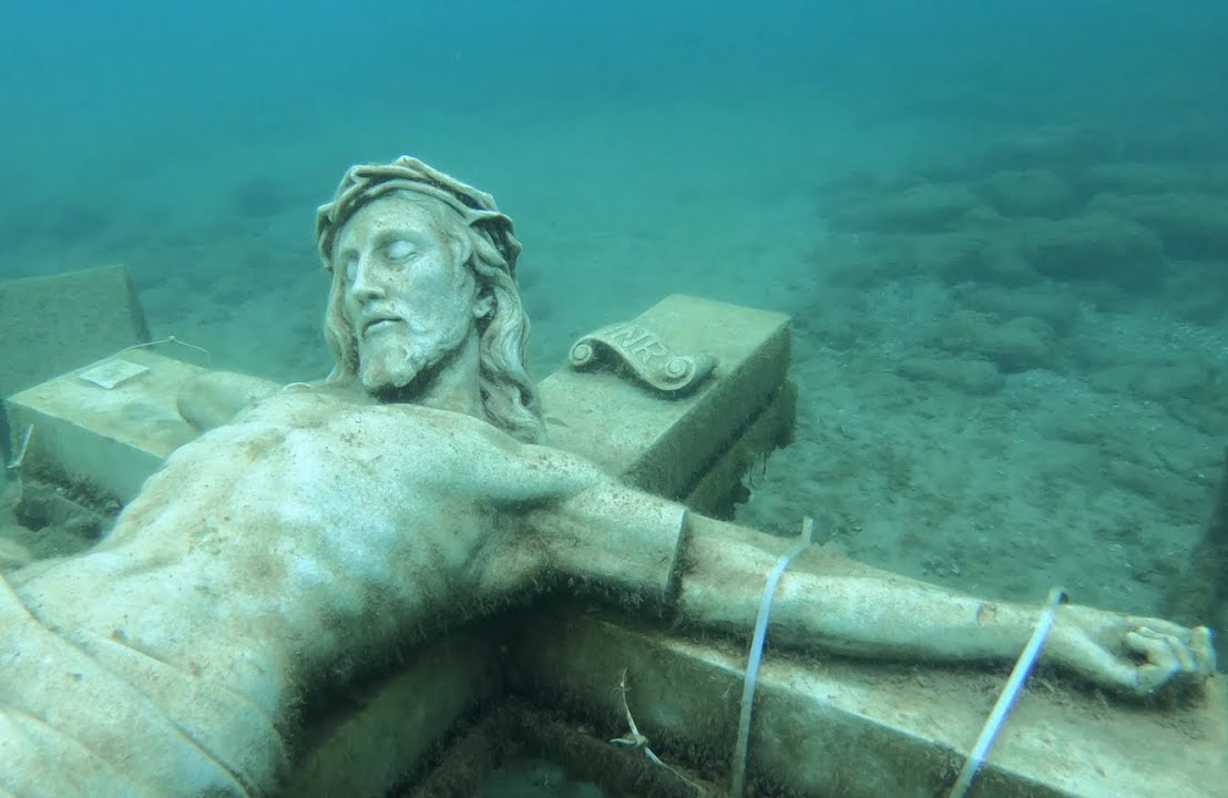 A marble crucifix lies at the bottom of Lake Michigan.