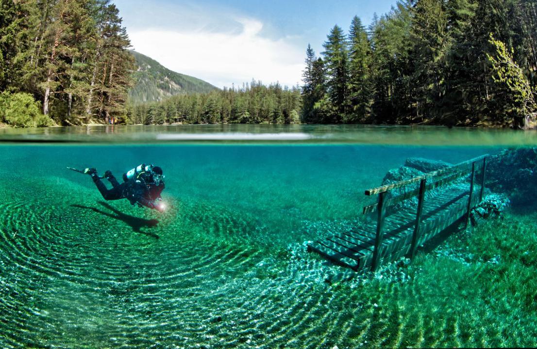 A diver swims through a flooded park in Austria.