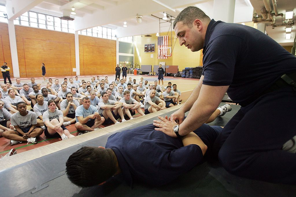Police officer Billy Pepitone demonstrates handcuffing technique