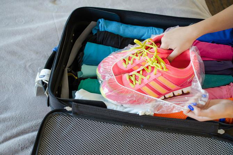 shoes-wrapped-in-shower-cap-for-luggage-99360