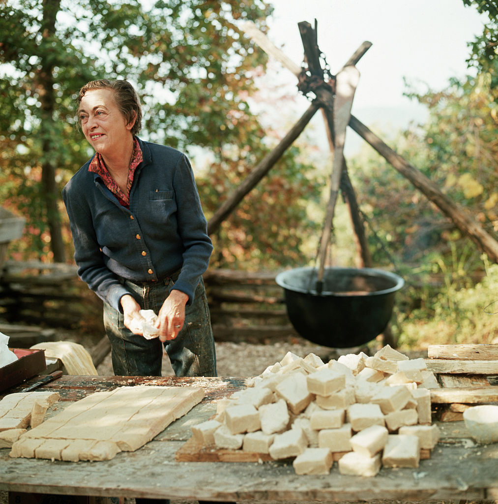 A woman makes cakes of lye soap