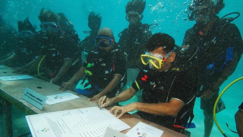 underwater government meeting