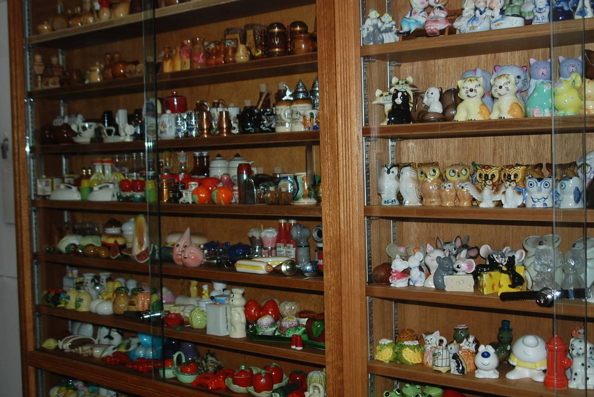 Salt and pepper shakers are on display at a museum.