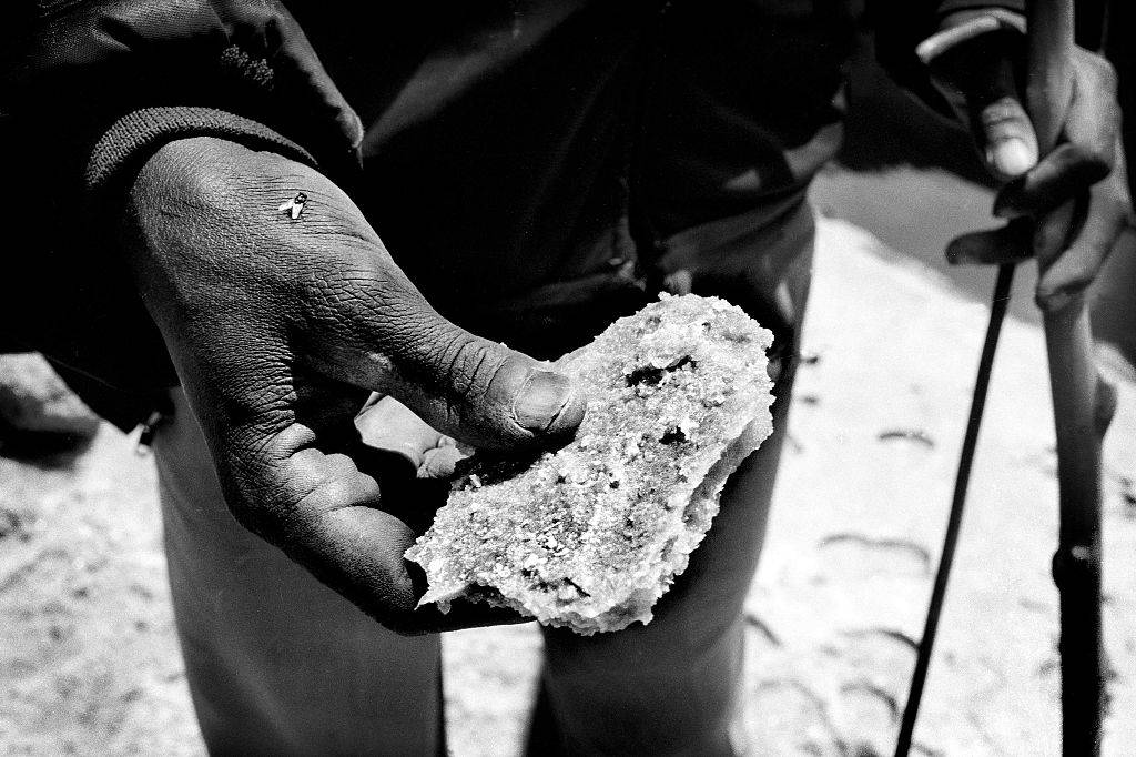 Man holding a salt rock