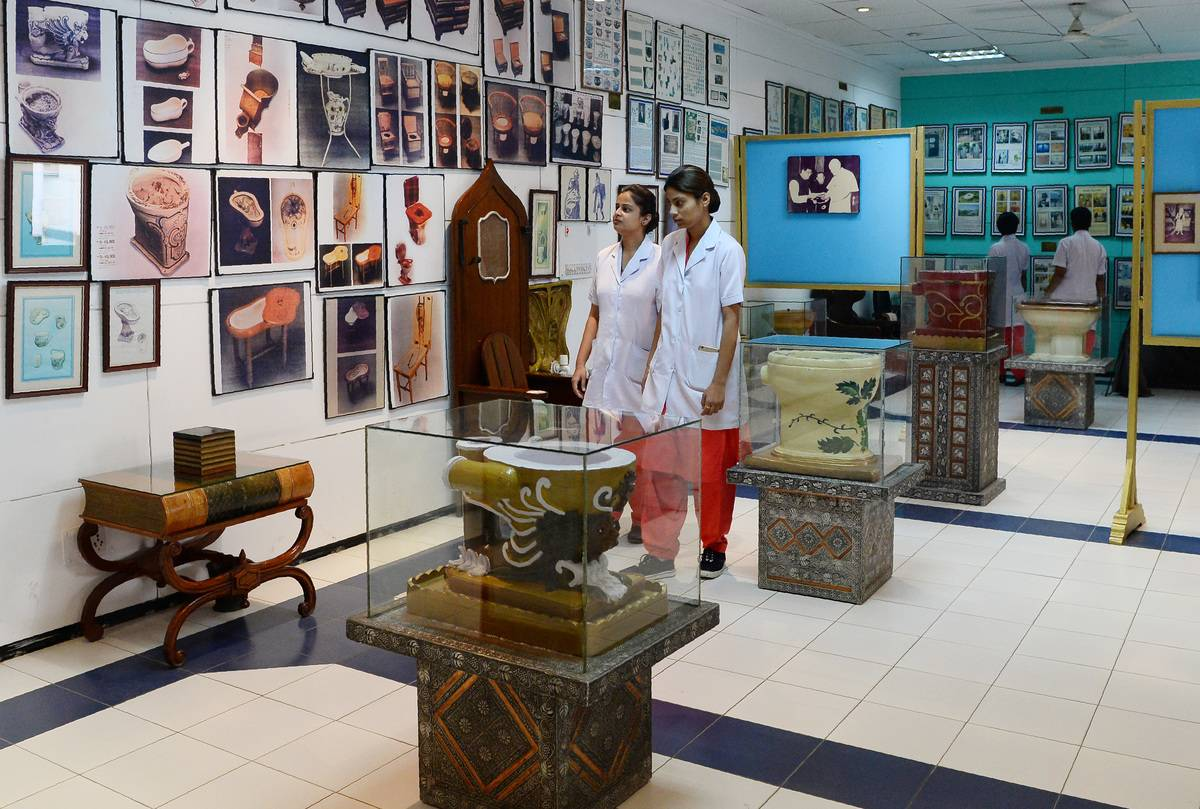 Nursing students walk through the Sulabh International Museum of Toilets in New Delhi.