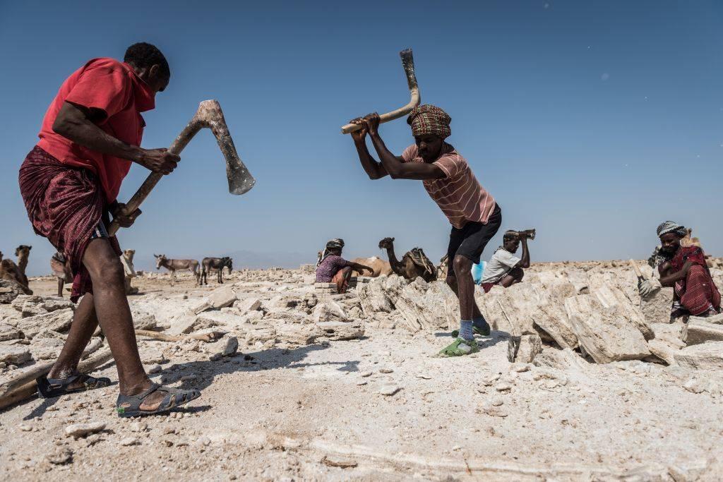 Boy mining salt