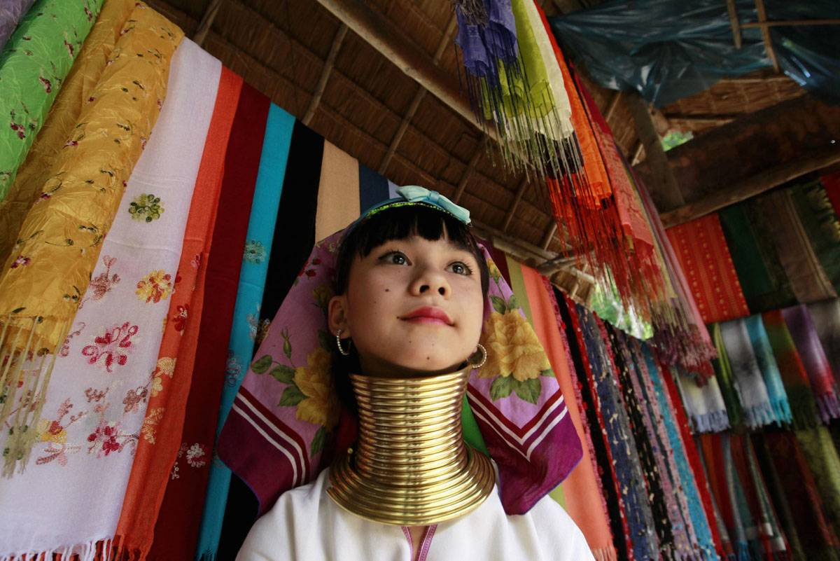 A young woman wears a brace to make her neck longer in northern Bangkok.
