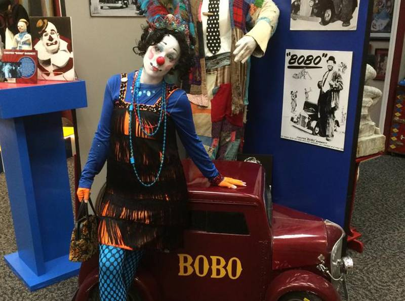 A photo shows a clown exhibition at the International Clown Hall of Fame.