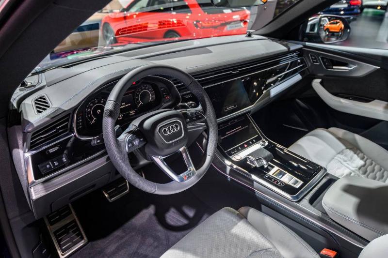 an audi car dashboard and steering wheel