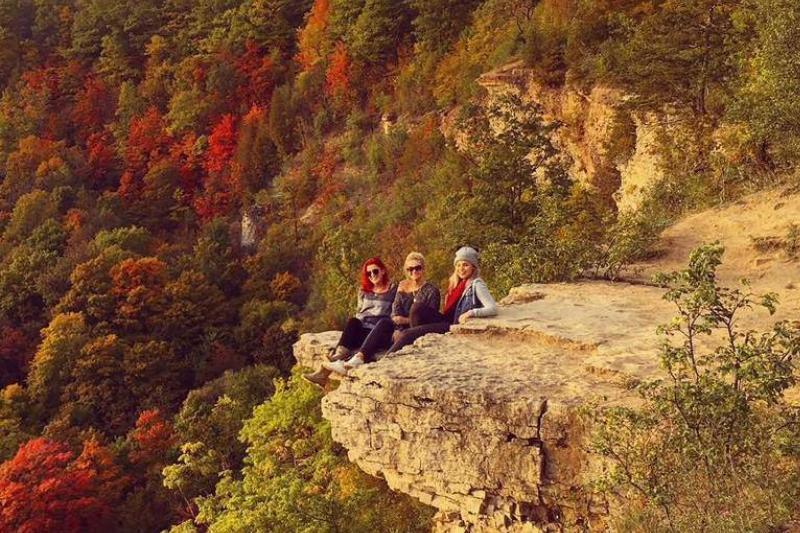 Woman pose together at Dundas Peak.