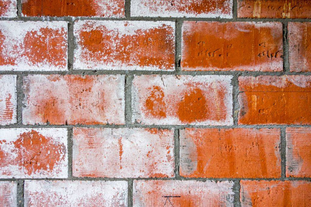 a brick wall with scuff marks