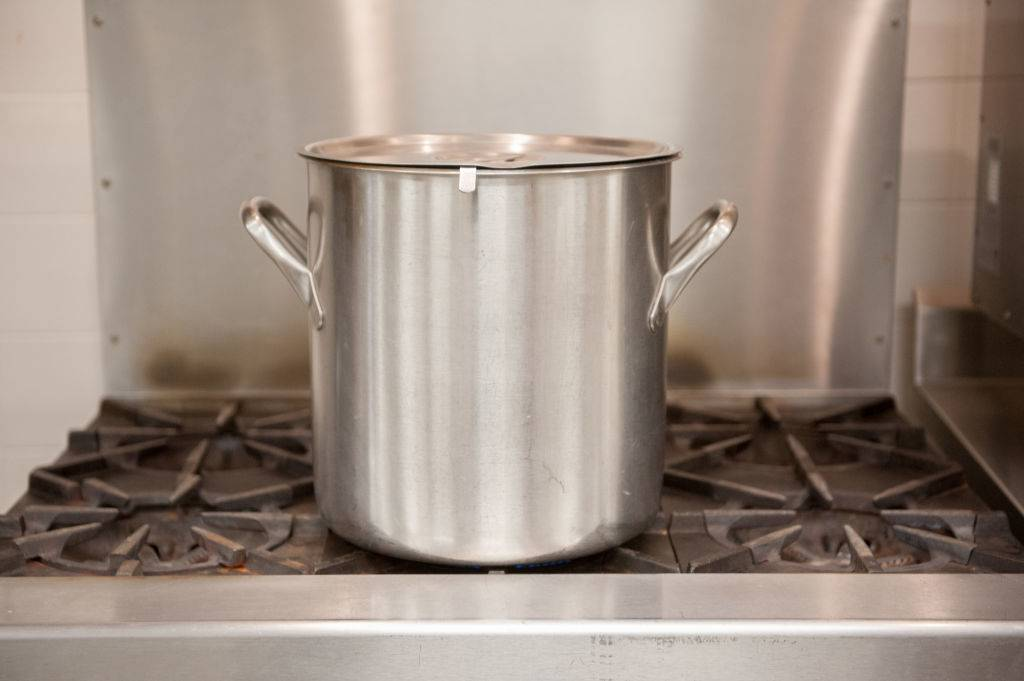 a stainless steel soup pot on a stove