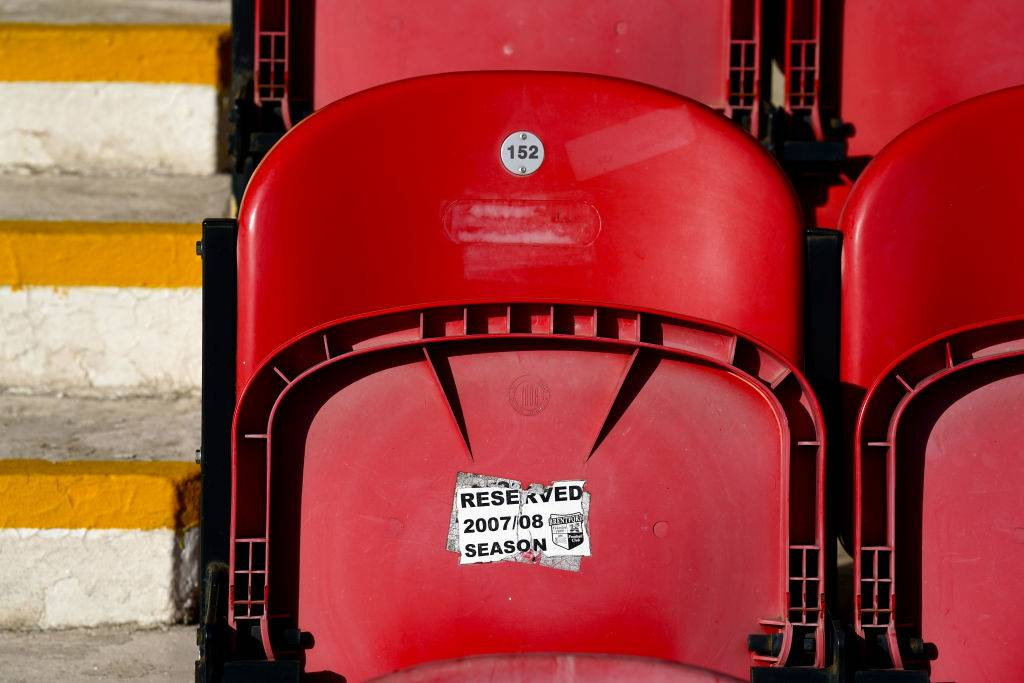 sticker residue on a red stadium seat
