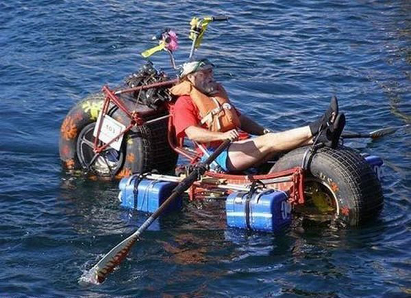 man on a motorcycle boat