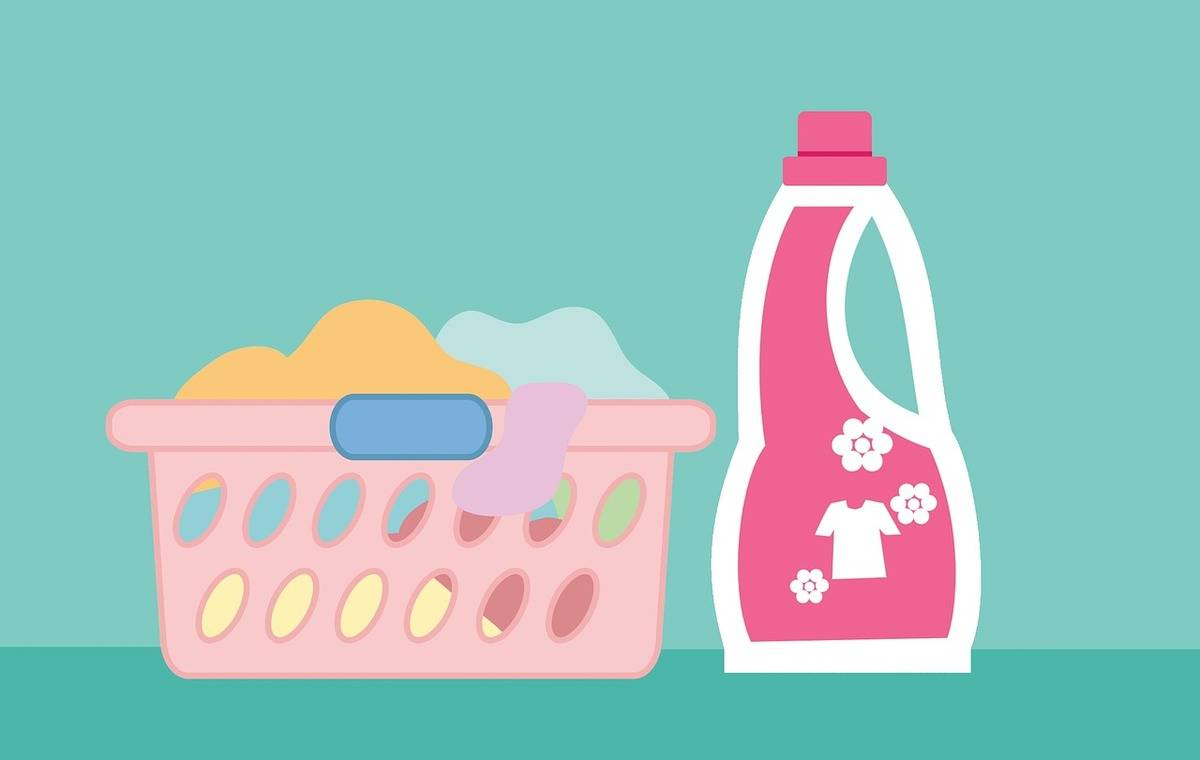 A graphic shows a laundry basket filled with clothes next to detergent.