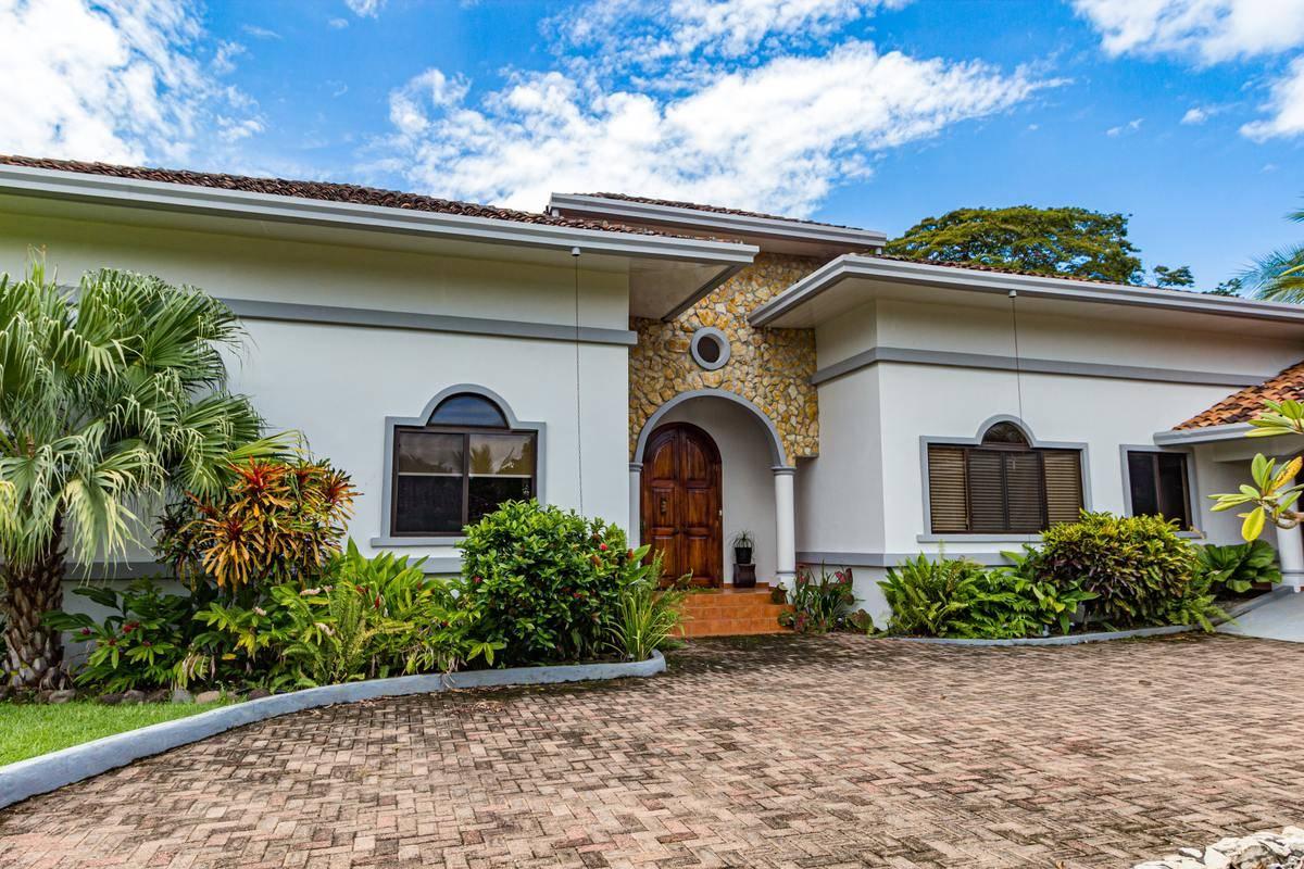 A house has a stone driveway.