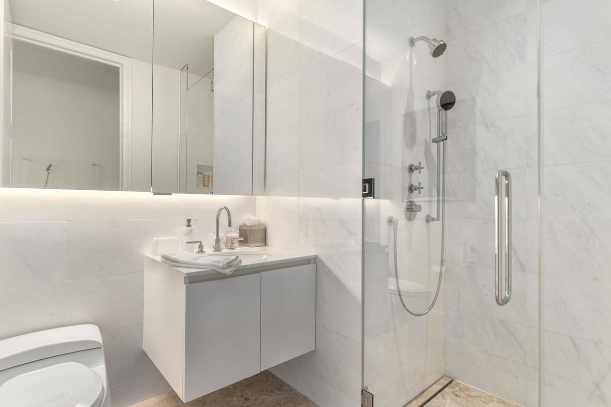A white bathroom features a shower stall.
