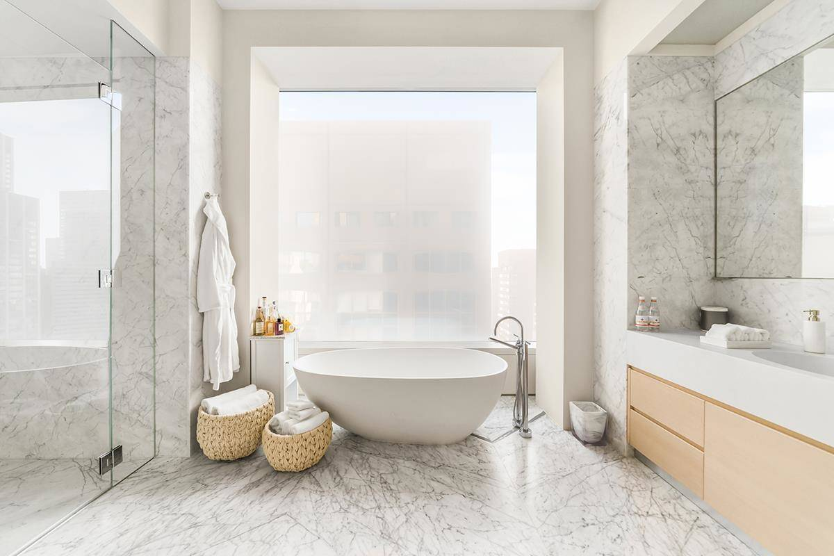 A second master bathroom features a tub.