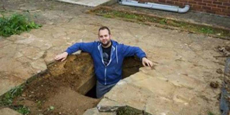 man-standing-in-hole-68534