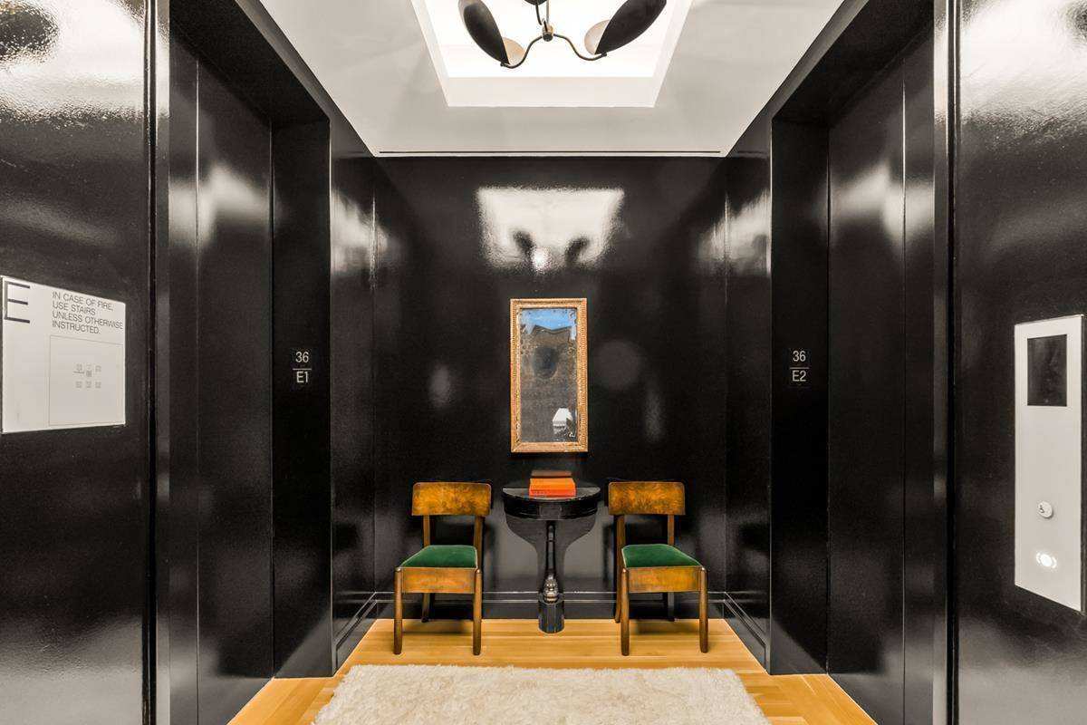 A private elevator room features a small seating area.