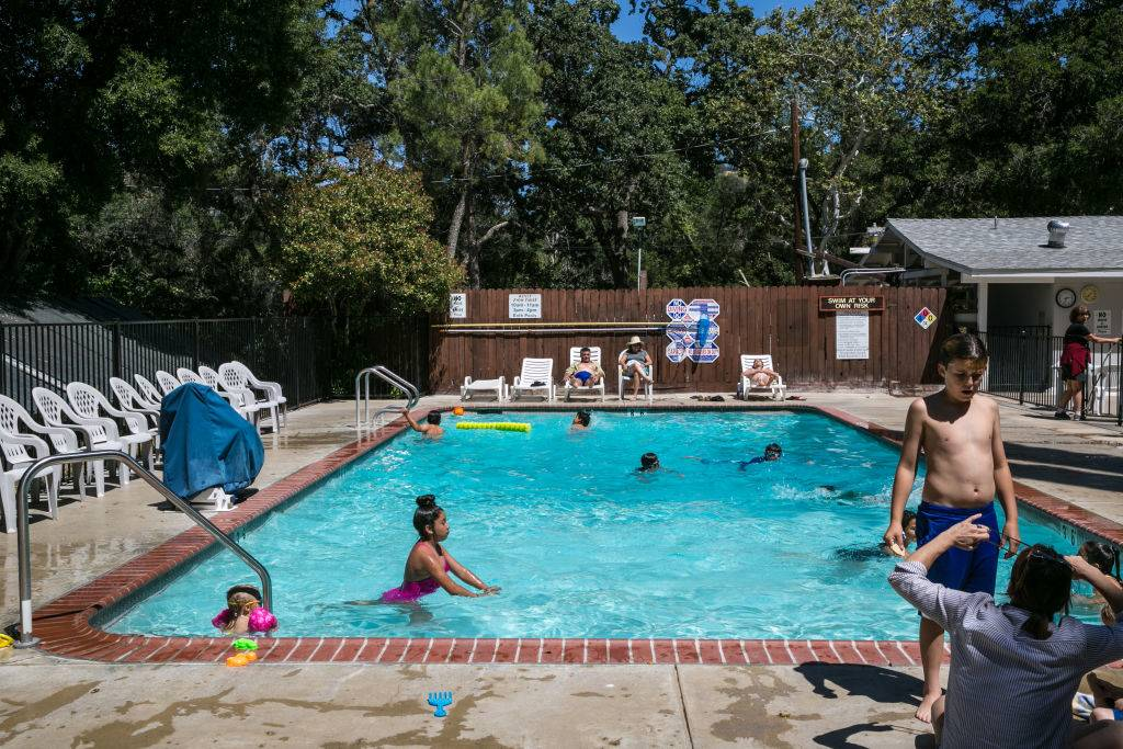 Kids play in the pool at Rancho Oso Resort