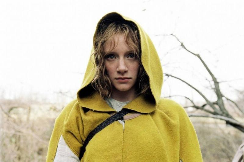 Woman in a yellow coat