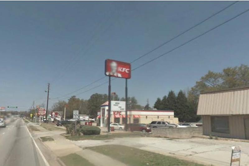 Google Street View blurs KFC's Colonel Sanders on a sign.