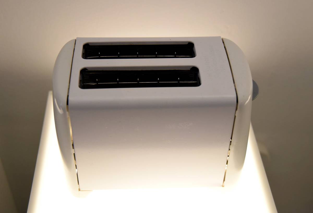 A picture shows a white toaster.