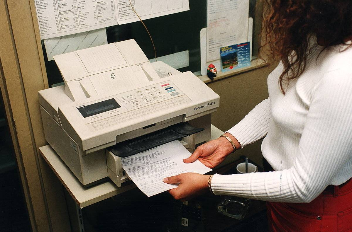 Fax Machines Live To Collect Dust And Cobwebs