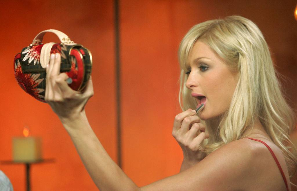 paris hilton applying lipstick