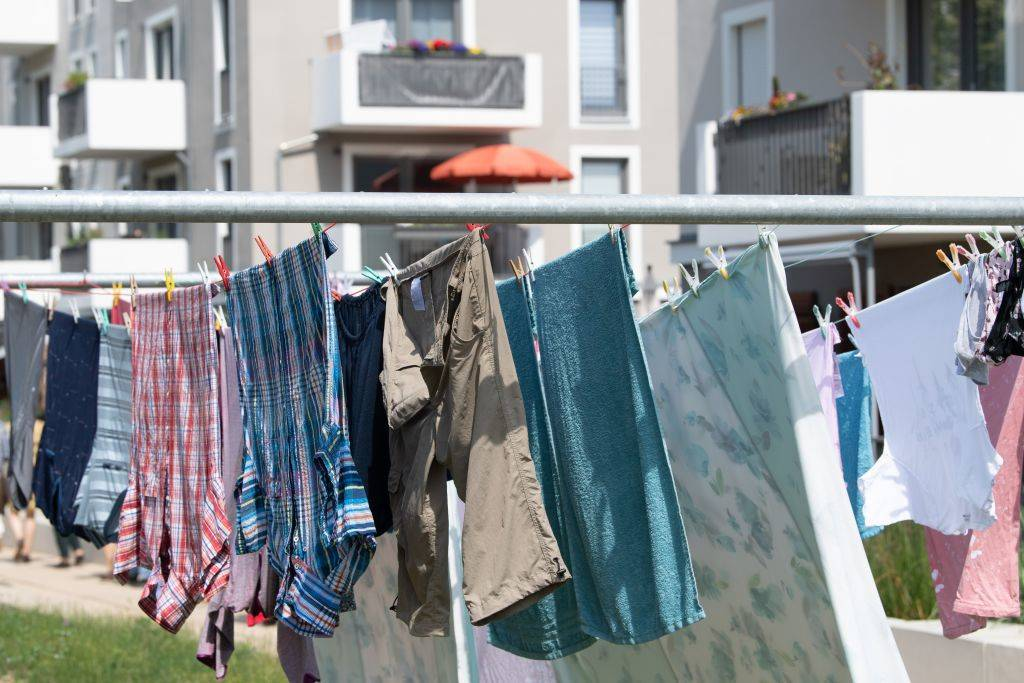 clothes and linens hung up on a clothesline