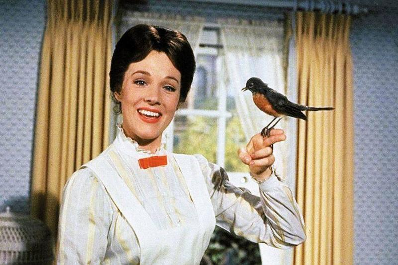 mary poppins holding a bird while singing