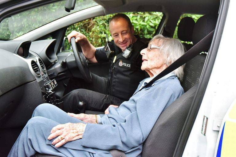 Anne Was All Smiles In The Police Car