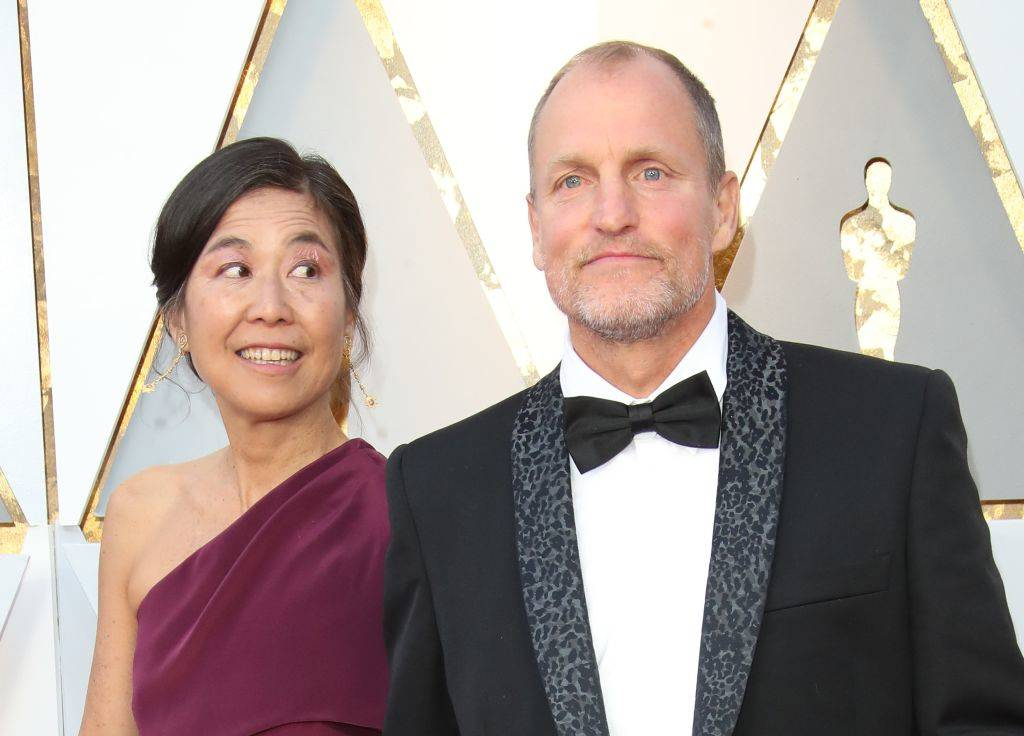Laura Louie (L) and Woody Harrelson attend the 90th Annual Academy Awards