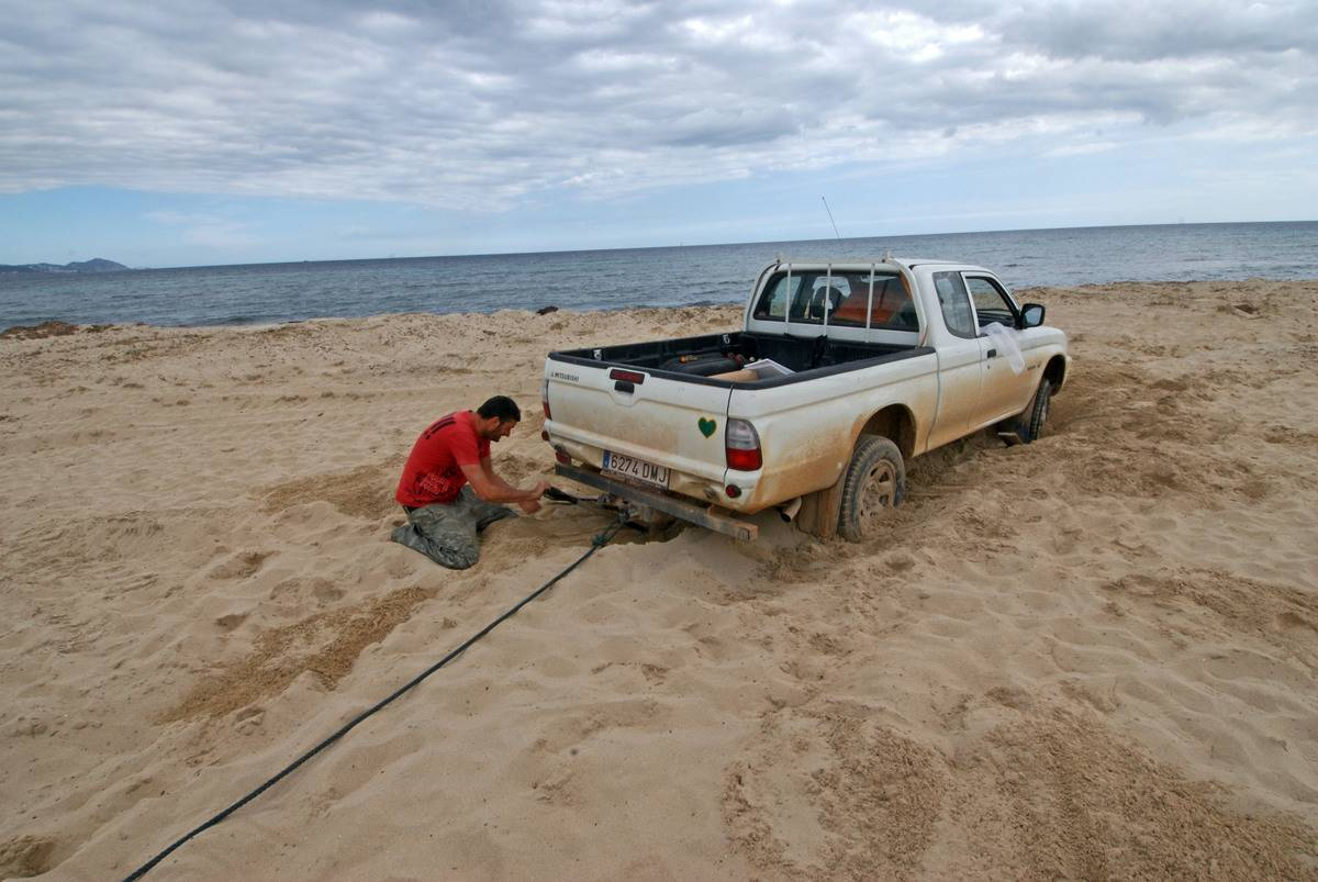 While On A Drive, Their Car Wound Up Stuck In The Sand