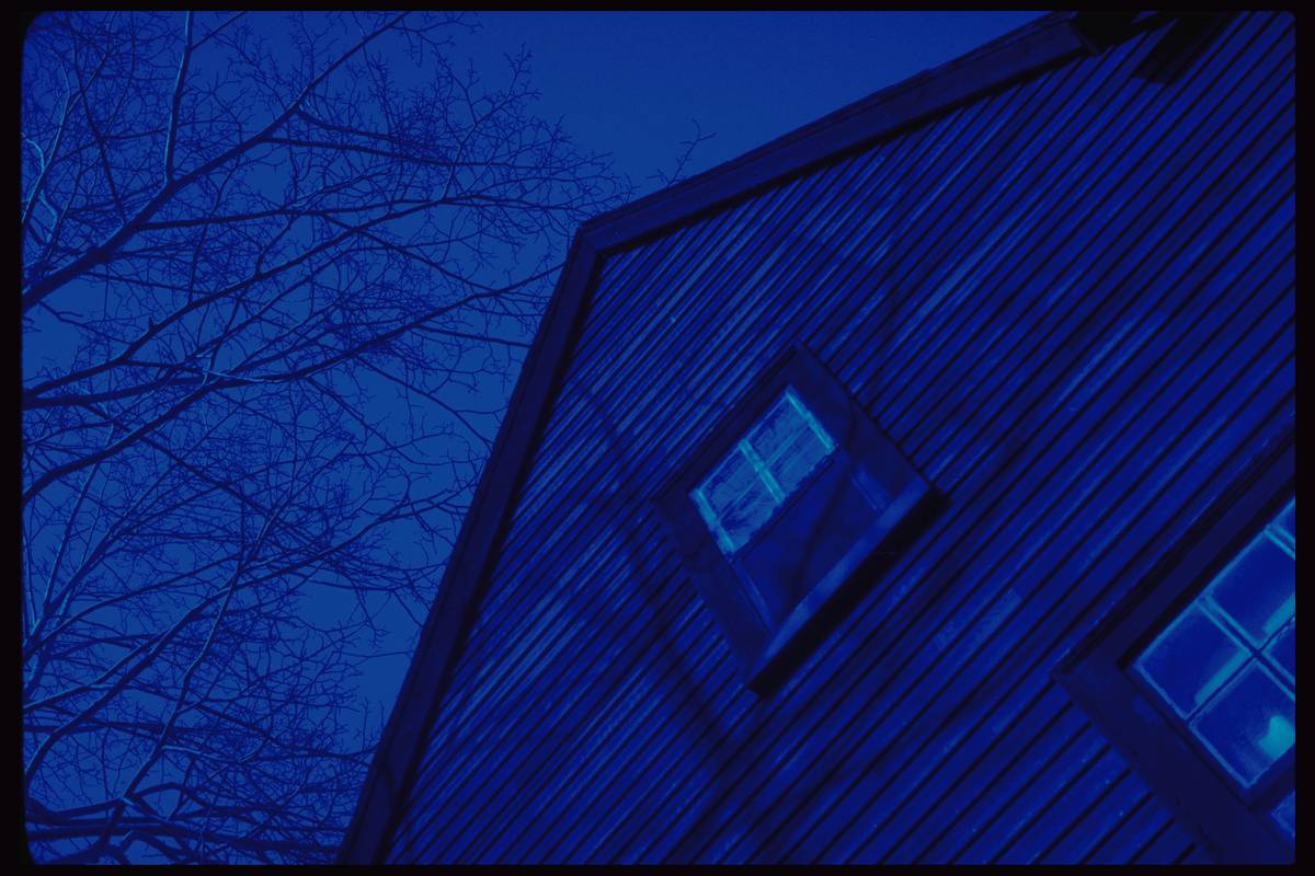 The outside of the House Of The Seven Gables is pictured at night.