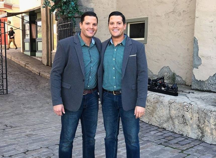 The Salyer twins pose in matching suits.