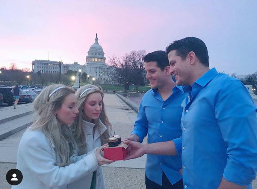 The Salyer twins hand the Deane twins a cupcake on Independence Day.