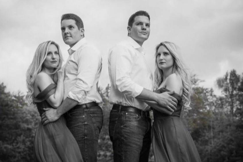 The Salyer couples pose for a black and white Halloween photo.